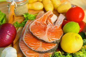 33716471 - delicious  portion of fresh salmon fillet  with lemon and vegetables