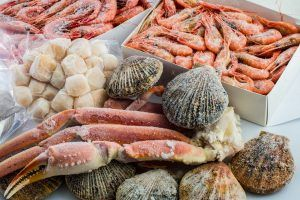 frozen shells of scallops, shrimps , crabs in a package